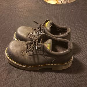 Dr. Martens steel toed boots.